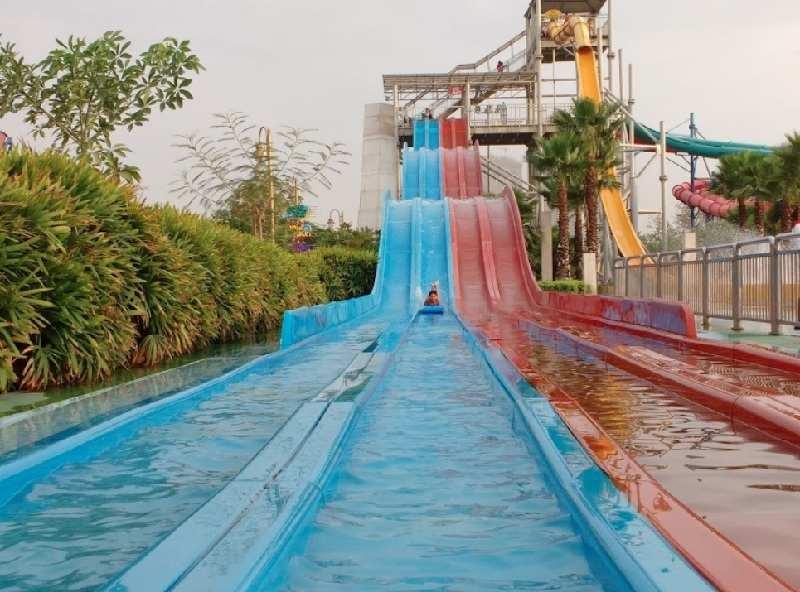Boy enjoying water Slide in Worlds of Wonder Water Park Noida